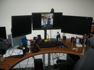 My 3 monitor swivel arm stand. Now I just need to clean up the desk. :-)